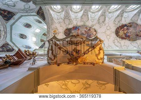 Feb 4, 2020 - Salzburg, Austria: Upward Ultrawide View Of Rococo Floral Mural Decorated Pulpit Insid