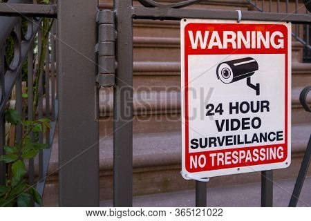 Red White And Black Safety Security Sign With Camera Icon And Test That Read