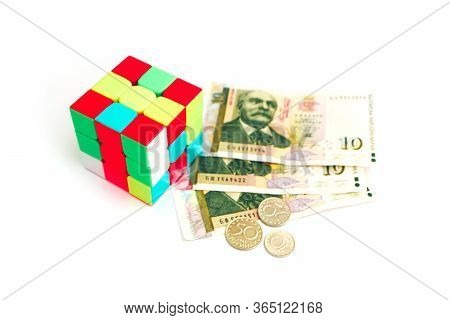 Bulgaria, Sofia - 10 April 2020: Rubik's Cube Puzzle, Isolated On White Background. Bulgarian Paper