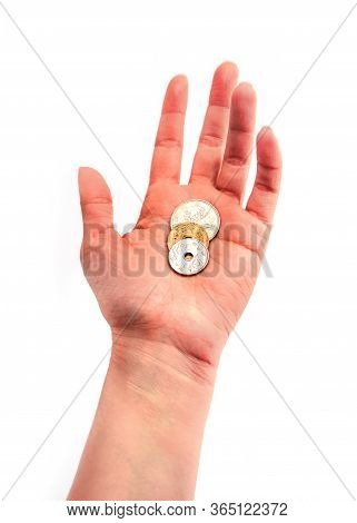 A Hand Holding Chinese Coins, Isolated On White Background. Asian Money And Business Concept.
