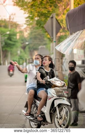 Bangkok, Thailand - May 07: Unnamed Mother And Daughter Rides A Motorcycle Without Helmet Through Th