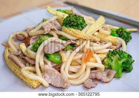 Tasty Stir Fried Udon Thick Noodles With Pork, Corn And Broccoli