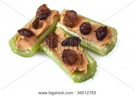 Ants on a log, celery with peanut butter and raisins, isolated on white.  Healthy snacks.