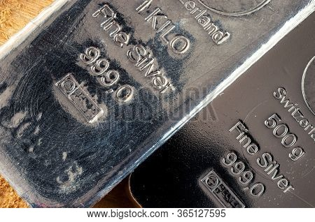 The Surface Of Two Different Silver Bullion Lying Diagonally.