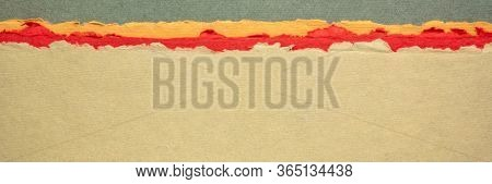 desert or badlands abstract landscape - a collection of colorful handmade Indian papers produced from recycled cotton fabric, panoramic web banner