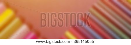 School Supplies On Dark Background. Back To School Background. Notepad And Stack Of Colorful Pencils