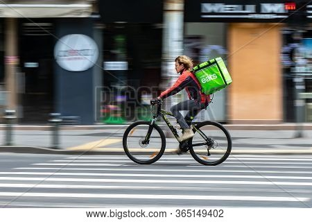 Bucharest, Romania - May 07, 2020: An Uber Eats Food Delivery Courier On A Bike In High Speed. Resta