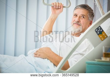 Senior male patient in a modern hospital (shallow DOF; color toned image)