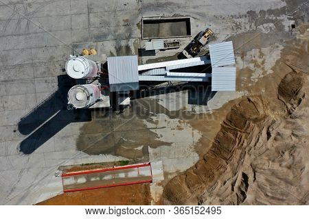 Asphalt production plant. Sand, gravel and cement mixed for construction and road works