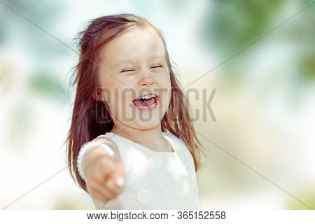 Cute Girl Kid You Pointing Fingers Looking At You, Camera Laughing. Closeup Portrait Of Caucasian Ki