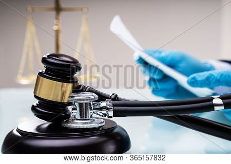 Medical Malpractice Litigation. Lawyer Or Judge In Courtroom