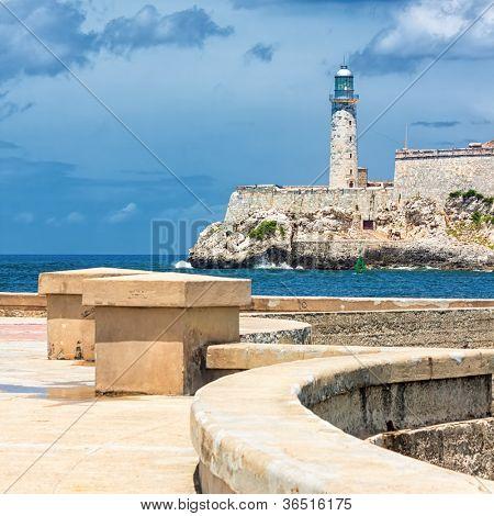 The castle of El Morro, a symbol of Havana, with the famous promenade known as El Malecon