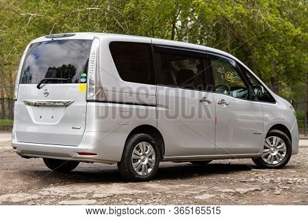 Novosibirsk/ Russia - May 02 2020: Silver Nissan Serena,  Back View.  Modern Seven-seater Minivan Ma