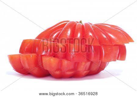 sliced wrinkled zapotec heirloom tomato on a white background