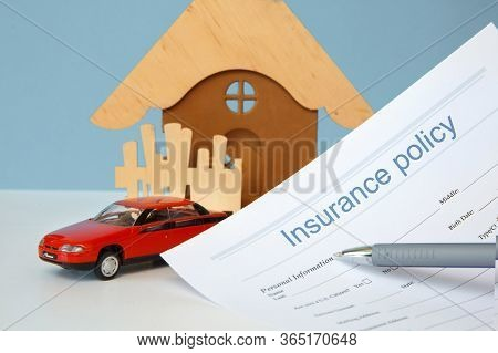 Insurance Concept. Car And Real Estate Insurance. Insurance Policy