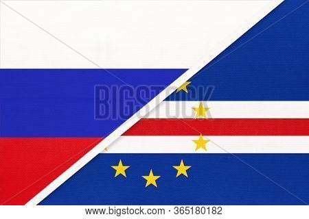 Russia Or Russian Federation Vs Cape Verde Or Cabo Verde, Symbol Of Two National Flags From Textile.