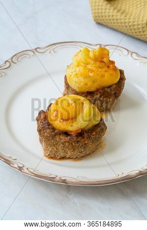Turkish Food Hasanpasa Kofte / Kofta With Puree / Meatball With Bechamel Sauce And Green Peas.