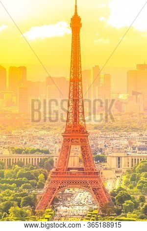 Sunset On Cityscape Skyline Of Paris With Eiffel Tower On Background. Seasonal Picturesque Backgroun