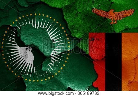 Flags Of African Union And Zambia Painted On Cracked Wall