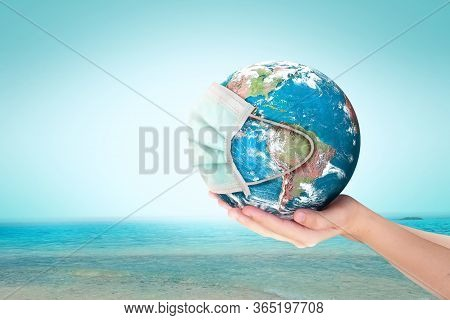 World Oceans Day Concept: Corona Virus Or Covid-19 Earth Wearing A Mask , This Image Furnished By Na