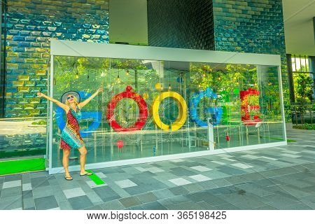 Singapore - May 5, 2018: Tourist Playing With The Interactive Google Sign In The Main Building New G