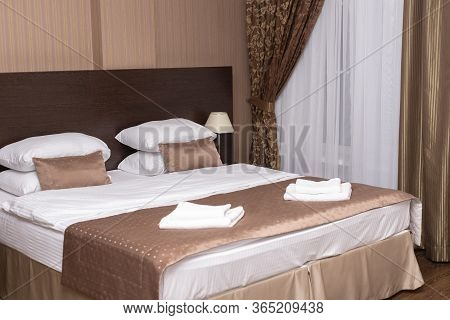 Typical Hotel Room With Double Bed In Classic Style