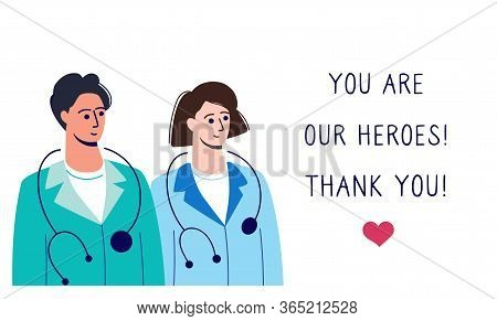 Two Doctors In Uniform And The Inscription You Are Our Heroes. Thank You Doctor - A Hero In 2020, Is