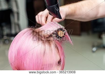 Hairdresser Is Drying Pink Hair With Hair Dryer And Round Brush. Hairdresser Blow Drying Short Pink