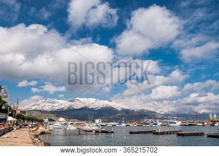 Sea Landscape Of Gaeta With Cloudy Sky And Snowy Mountains On Background. Gaeta Is A Small Medieval