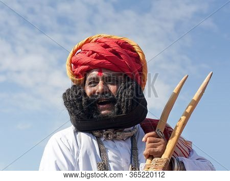Bikaner, Rajasthan, India - January 11, 2020: Girdhar Vyas Demonstrate His Famous Moustaches. He Sta