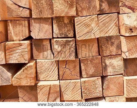 Stack Of Wooden Squared Beams Background Or Texture Concept