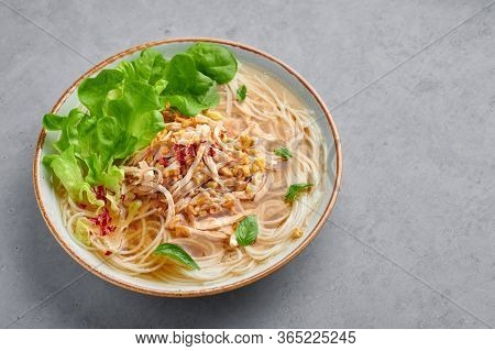 Guay Tiew Gai Cheek Or Thai Chicken Noodle Soup In White Bowl On Gray Concrete Backdrop. Guay Tiew G
