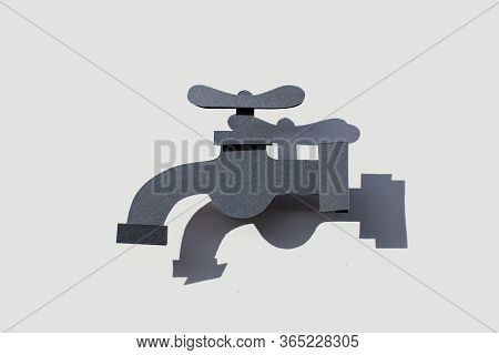 Paper Art Water Tap On Isolated Background. Symbol. Handmade Craftwork. Cutout.
