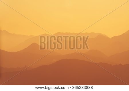 Beautiful Orange Layers Of Hills And Mountains During Sunset In Slovenia. Tourism, Hiking, Nature, E
