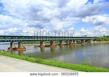 Long Bridge Over Wisla In Warsaw. Modern Bridge Over Wisla River In Warsaw. Landscape With River Clo