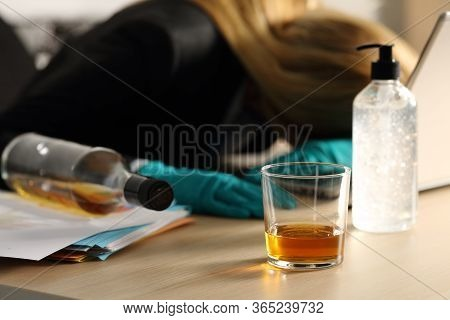 Close Up Of Drunk Entrepreneur Woman Sleeping On Desk On Covid-19 Confinement At Homeoffice