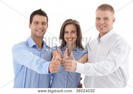 Young successful businessteam giving thumb up, smiling, team spirit, isolated on white.