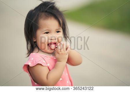 Little Child Girl Enjoy Eating Lollipop Candy, Kid Thailand