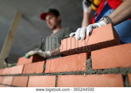 Builders Make Wall Brick And Cement, Technology. Builders Use Cement Mixtures That Bricks Bind Toget