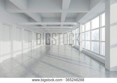 Interior Of Empty Panoramic Industrial Style Office With White Walls, Concrete Floor, Row Of Lamps,