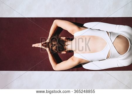 Young Woman Practicing Yoga On Yoga Mat Indoors.