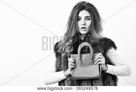 Female Stylish Fashion Model. Woman In Fur Coat With Handbag On White Background. Girl Fashion Lady