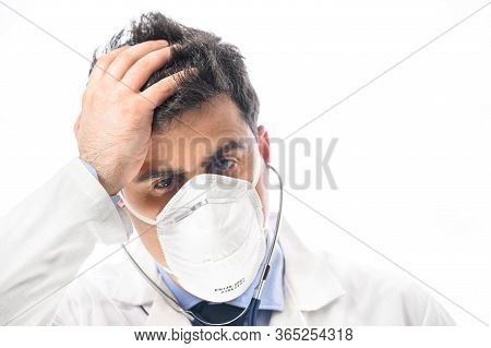 Anxious And Nervous Doctor. Close Up Portrait, Of A Doctor In Protective Face Mask With Worried Expr