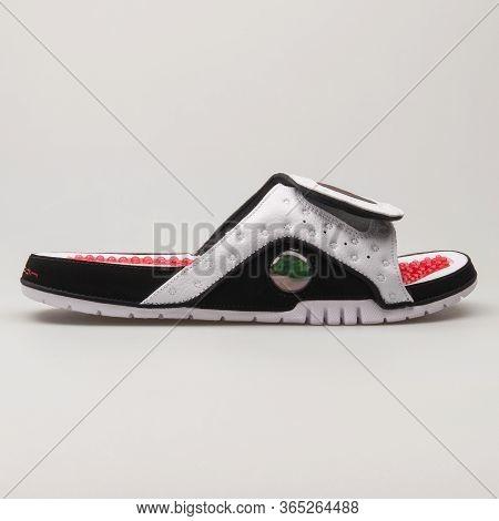 Vienna, Austria - June 14, 2018: Nike Jordan Hydro 13 Retro White, Black And Red Sandal On White Bac
