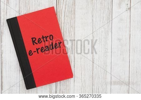 Retro E-reader Humorous Message On A Book On Weathered Whitewash Wood