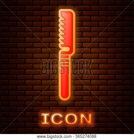 Glowing Neon Medical Saw Icon Isolated On Brick Wall Background. Surgical Saw Designed For Bone Cutt
