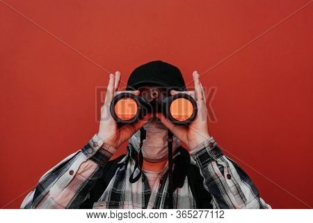 The Guy Looks Through Binoculars At The Camera.