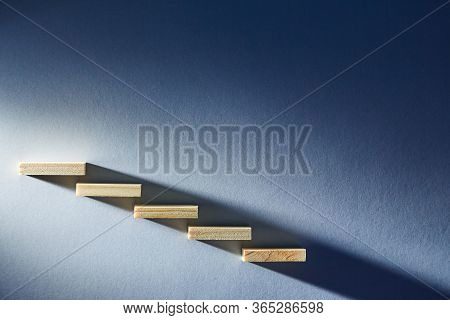 Decrease Or Increase. Symbol For Growth Or Fall. Wooden Blocks As Ladder. Copy Space. Reduction And
