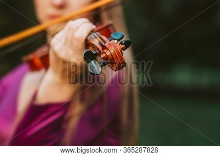 October 2019, A Girl In A Purple Dress In A Green Park Enjoys The Fresh Air With A Violin And Bow, I