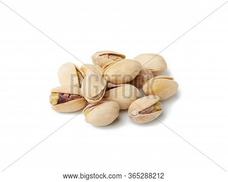 Bunch Of Salted Open Inshell Pistachios Isolated On A White Background, Tasty And Healthy Snack
